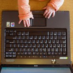 Baby hands with laptop
