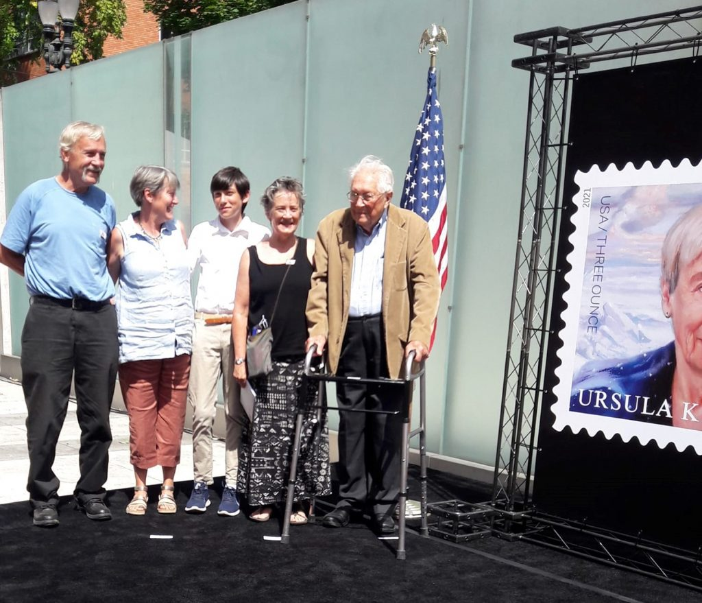 Le Guin's family beside the unveiled stamp poster.